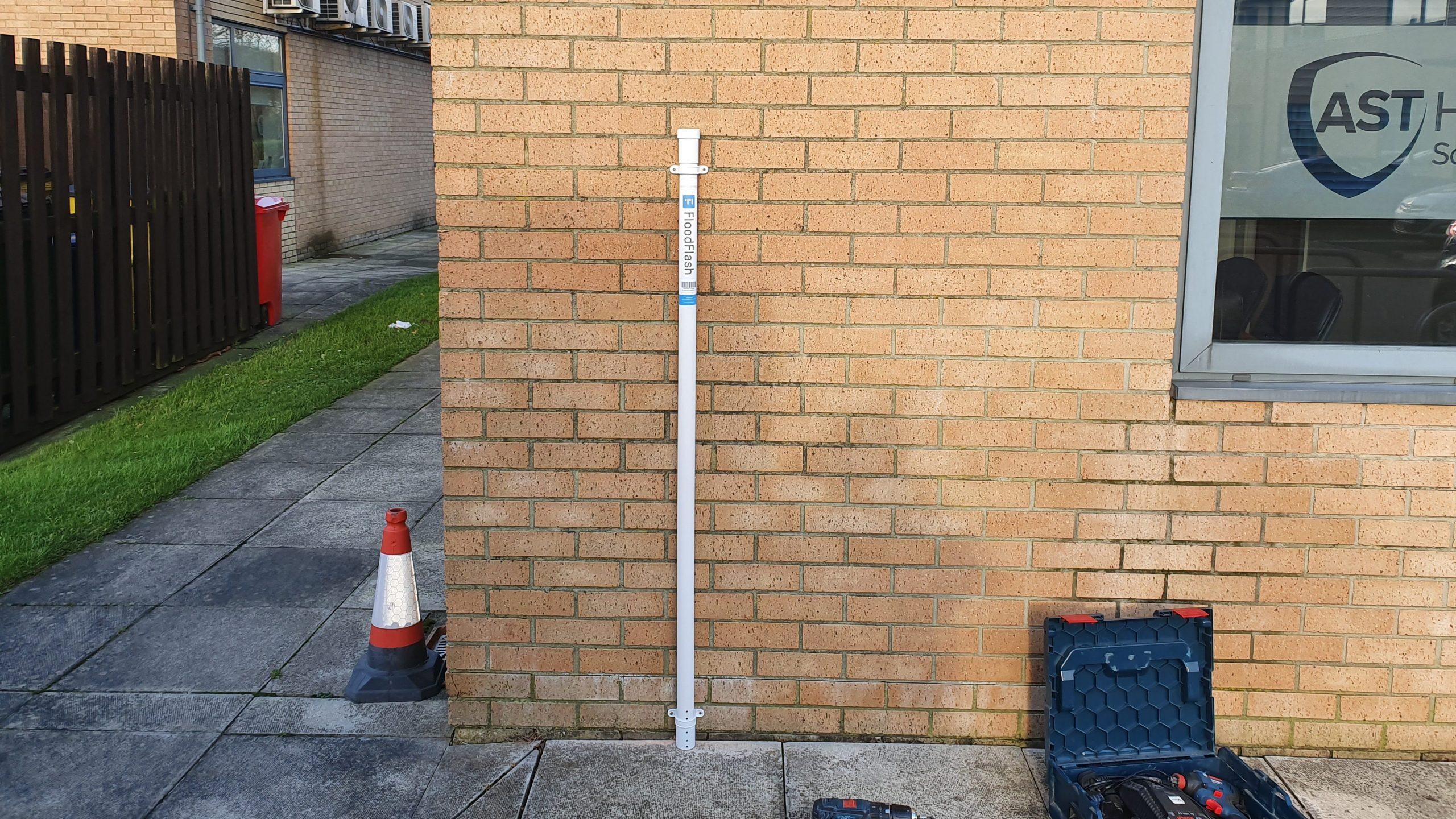 FloodFlash sensor on the side of a building